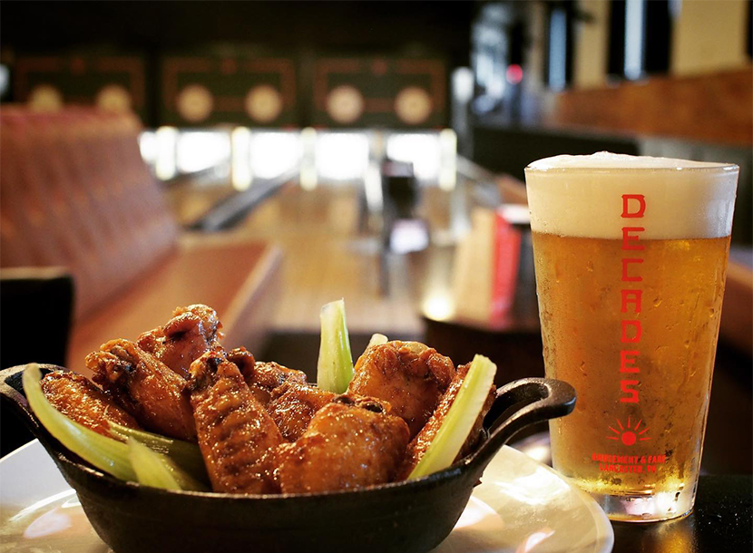 Chicken wings and beer from Decades.